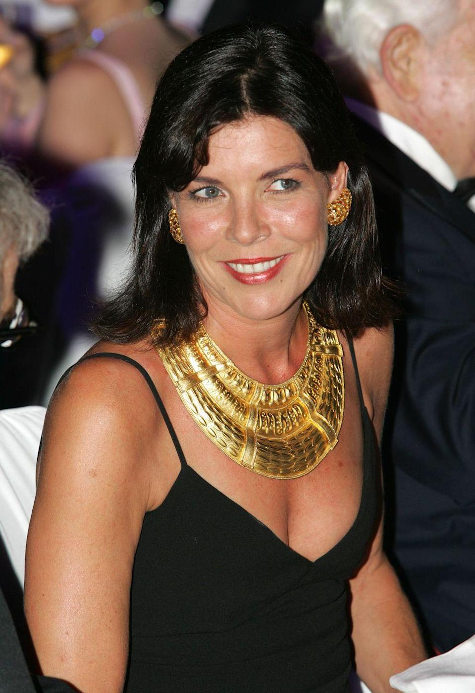 <p>Princess Caroline in a stunning gold collar at the Red Cross Ball in 2004.</p>