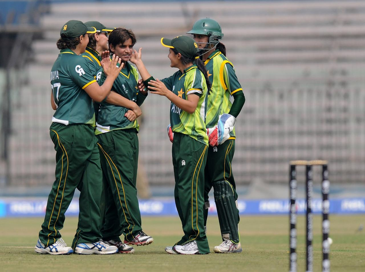 CUTTACK, INDIA - FEBRUARY 01:  Sadia Yousaf of Pakistan celebrates the wicket of Lisa  Sthalekar  of Australia with teammates during the second match of ICC Womens World Cup between Australia and Pakistan, played at the Barabati stadium on February 1, 2013 in Cuttack, India.  (Photo by Pal Pillai-ICC/ICC via Getty Images)
