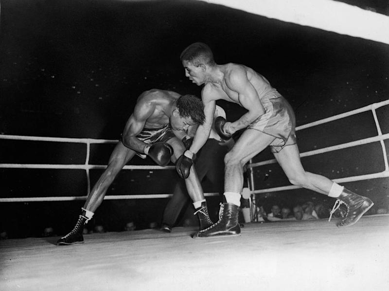 Randolph Turpin (R) stunned Sugar Ray Robinson at Earls Court (Getty )