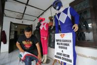 Man donning superhero costumes brings cheer to children confined to their homes by COVID-19 restrictions in Sukoharjo
