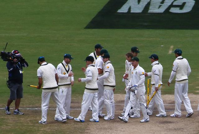 Australia's team celebrate after winning the second Ashes cricket test against England at the Adelaide Oval December 9, 2013. Australia captured England's four remaining wickets before lunch to close out an emphatic 218-run victory in the second Ashes test on Monday. REUTERS/David Gray (AUSTRALIA - Tags: SPORT CRICKET)