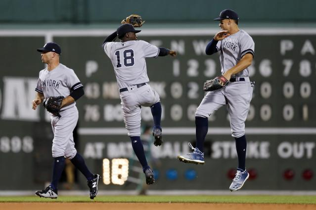 New York Yankees' Aaron Judge, right, and Didi Gregorius celebrate after defeating the Boston Red Sox during a baseball game in Boston, Sunday, Sept. 8, 2019. (AP Photo/Michael Dwyer)