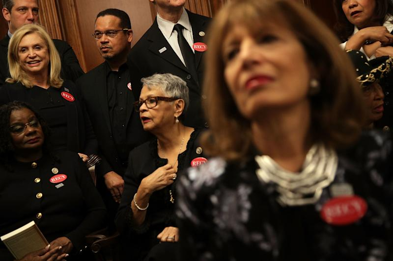 U.S. Rep. Gwen Moore (D-Wis.), Rep. Bonnie Watson Coleman (D-N.J.), Rep. Keith Ellison (D-Minn.), Rep. Carolyn Maloney (D-N.Y.), Rep. Jackie Speier (D-Calif.) and other House Democrats wear black.