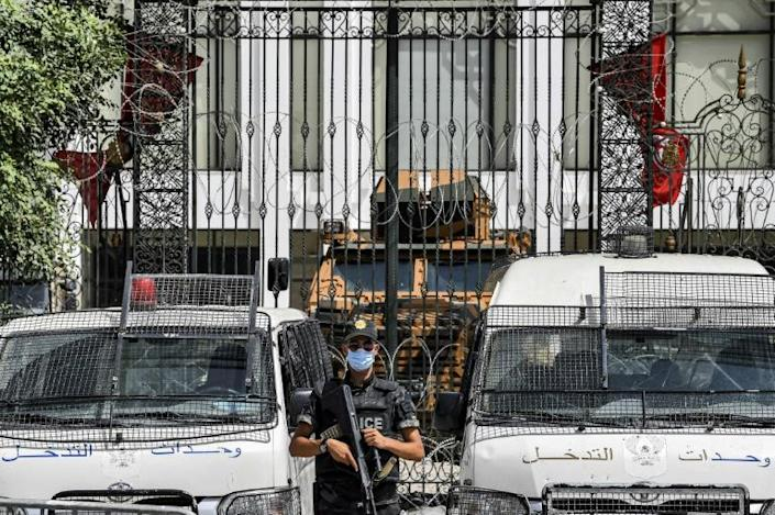 No entry: an armoured car and security forces stand guard outside parliament in Tunis on July 31, 2021