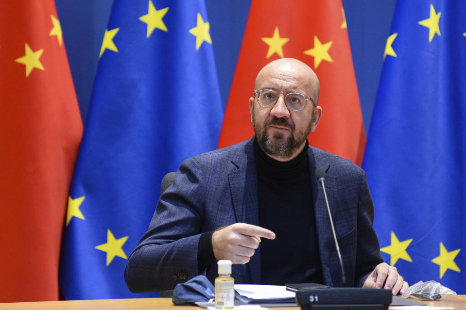 European Council President Charles Michel arrives for an EU-China Leaders' meeting video conference at the European Council headquarters in Brussels, Wednesday, Dec. 30, 2020. The European Union top officials and China president Xi Jinping will conclude Wednesday a business investment deal that will open big opportunities to European companies, with the potential to irk the new American administration. (Johanna Geron, Pool Photo via AP)