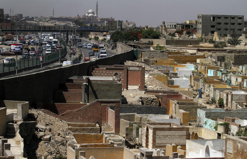 In this photo taken on Monday, May 21, 2012, a top view shows part of a necropolis called the City of the Dead where thousands of Egyptian families live, in Cairo, Egypt. The City of the Dead is a 4 mile (6.4 kilometers) long necropolis where thousands of Egyptians are forced to live and work alongside graves due to the scarcity of housing in the capital. (AP Photo/Khalil Hamra)