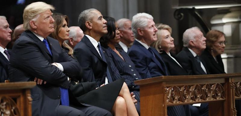 Donald Trump sits with former presidents at George H.W. Bush's funeral.