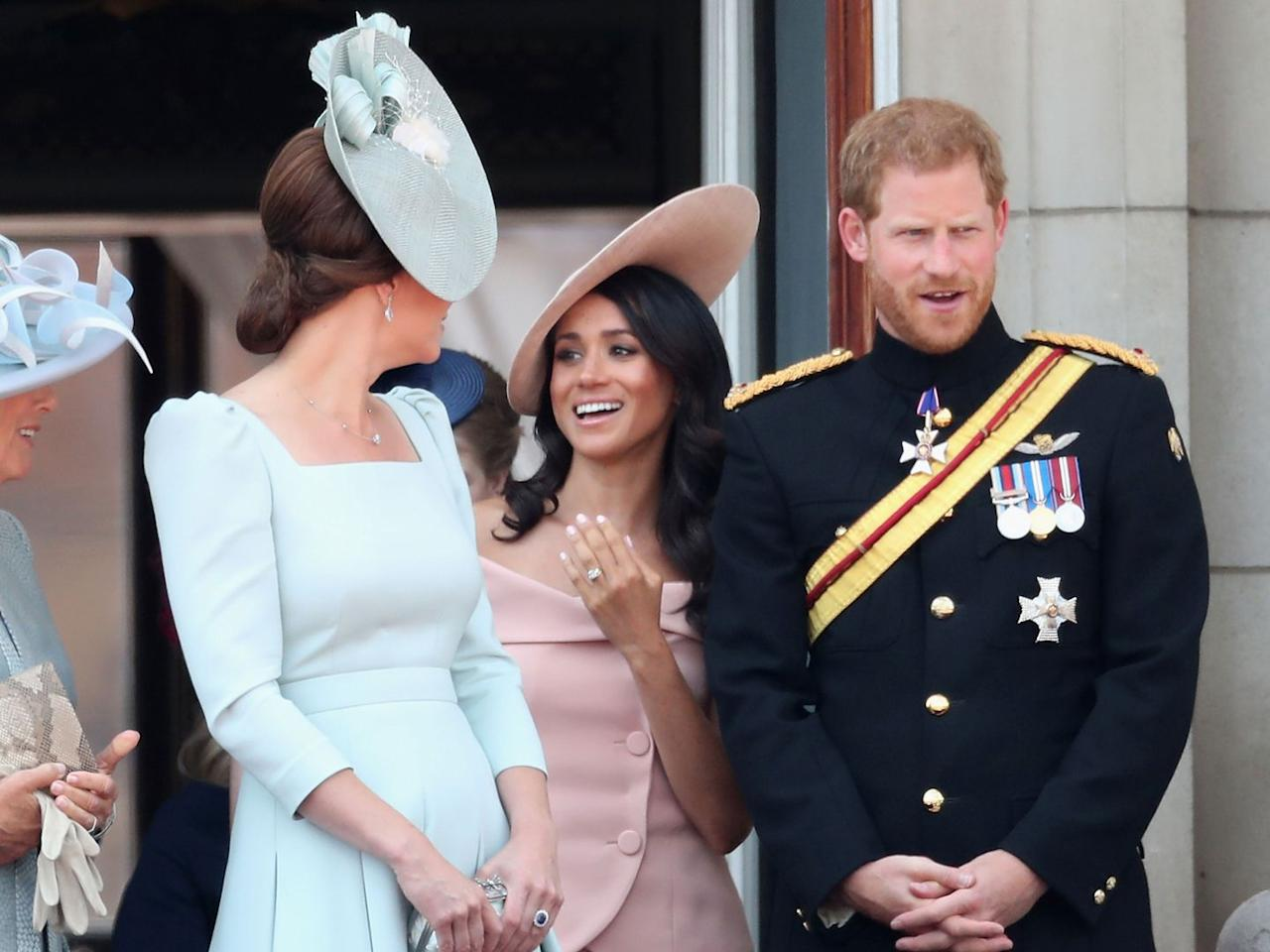 "<p>Although <a rel=""nofollow"" href=""https://www.harpersbazaar.com/uk/celebrities/news/a21250006/meghan-markle-prince-harry-trooping-colour-parade-support-words-nervous/"">Meghan was said to be nervous</a>, she looked at ease when chatting to Kate.</p>"