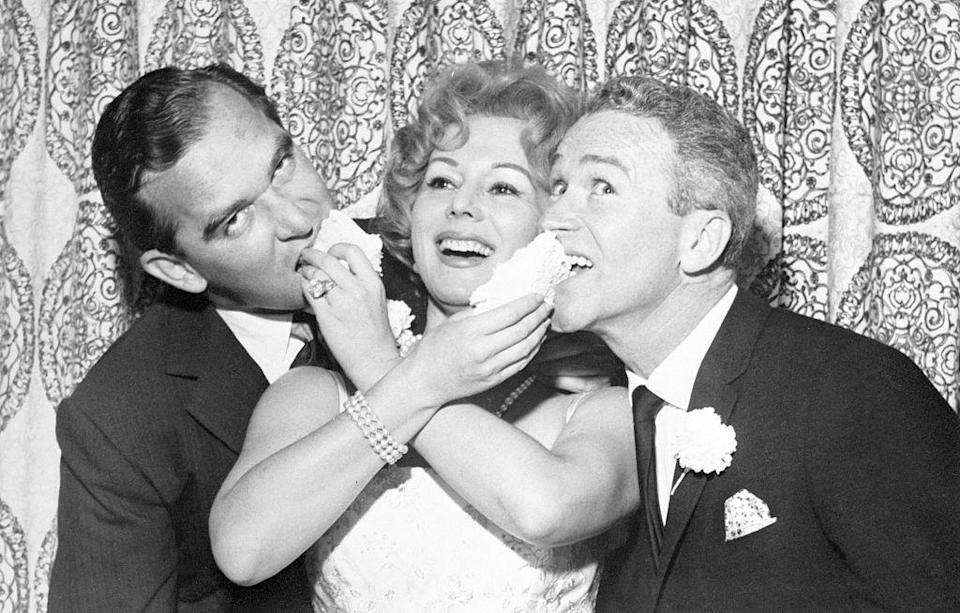 <p>Eva Gabor married her fourth husband, Richard Brown, at the Flamingo Hotel in Las Vegas. The actress was photographed feeding cake to her new husband (left) and his best man at the reception. </p>