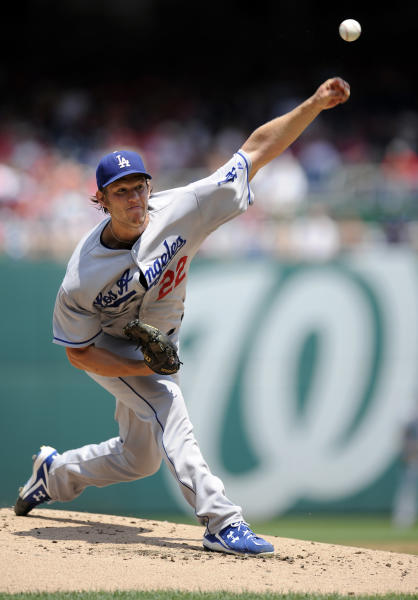 FILE - In this July 21, 2013, file photo, Los Angeles Dodgers starting pitcher Clayton Kershaw delivers a pitch against the Washington Nationals during the first inning of a baseball game in Washington. Kershaw won the National League Cy Young Award, Wednesday, Nov. 13, 2013. (AP Photo/Nick Wass, File)