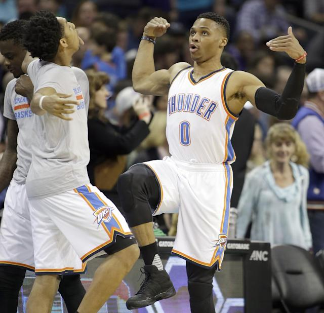 Payne and Russell Westbrook perform their pregame dance ritual earlier this season. (AP)