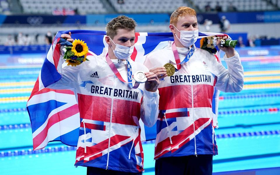 Great Britain's Tom Dean (right) with his gold medal after winning the Men's 200m Freestyle Final alongside Great Britain's Duncan Scott with his silver medal at the Tokyo Aquatics Centre on the fourth day of the Tokyo 2020 Olympic Games in Japan. - PA