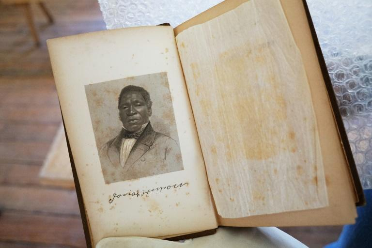 A photo taken on March 29, 2017 shows a portrait of Josiah Henson in a book he authored, at Josiah Henson Park in Bethesda, Maryland