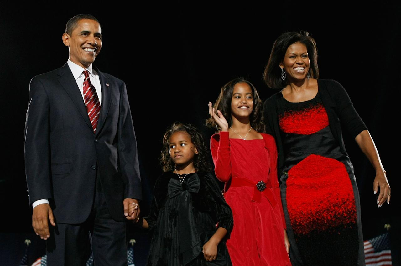 U.S. President elect Barack Obama acknowledges his supports along with his wife Michelle (R) and daughters Malia (2nd R) and Sasha to during an election night gathering in Grant Park on November 4, 2008 in Chicago, Illinois. (Photo by Joe Raedle/Getty Images)