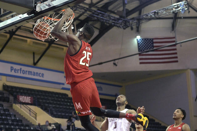 Maryland forward Jalen Smith (25) dunks the ball in front of Harvard forward Chris Lewis (0) during the second half of an NCAA college basketball game Friday, Nov. 29, 2019, in Lake Buena Vista, Fla. (AP Photo/Phelan M. Ebenhack)
