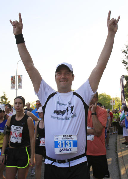 In this Sunday, May 20, 2012 photo, Congressman Tim Ryan waits to run in the Cleveland Marathon. In what's become a daily ritual, Ryan finds a quiet spot, closes his eyes, clears his mind and tries to tap into the eternal calm. Increasingly, people in settings beyond the serene yoga studio or contemplative nature path are engaging in the practice of mindfulness, a mental technique that dwells on breathing, periods of silence and concentration to keep one's thoughts in the present moment. (AP Photo/Tony Dejak)