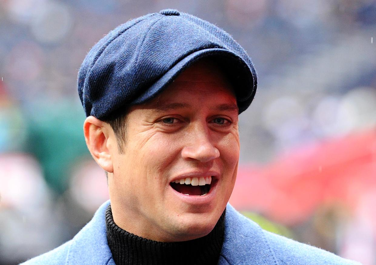 LONDON, ENGLAND - OCTOBER 13: TV presenter Vernon Kay looks on pitch-side prior to the NFL match between the Carolina Panthers and Tampa Bay Buccaneers at Tottenham Hotspur Stadium on October 13, 2019 in London, England. (Photo by Alex Burstow/Getty Images)