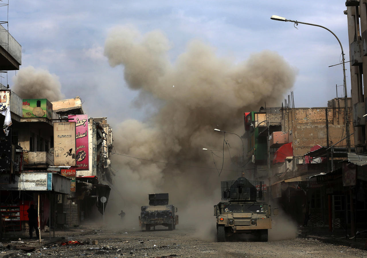<p>Three roadside bombs laid by Islamic State group militants explode in a western Mosul neighborhood, killing one of the Iraqi engineers attempting to diffuse the devices. Iraq, March 8, 2017. (Photo: Khalid Mohammed/AP) </p>