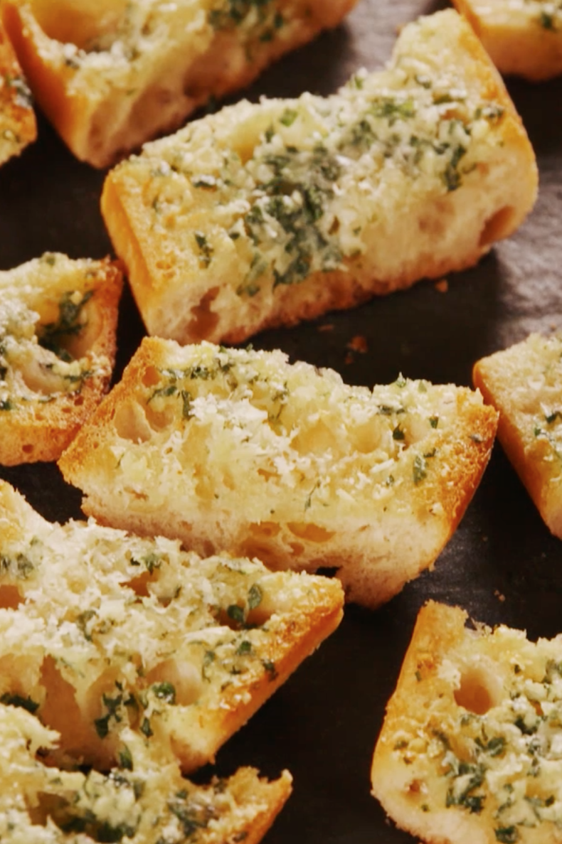 """<p>The secret to really good garlic bread is to keep it simple. And to use a lot of garlic—4 cloves for one loaf! </p><p>Get the <a href=""""https://www.delish.com/uk/cooking/recipes/a30255379/easy-garlic-bread-recipe/"""" rel=""""nofollow noopener"""" target=""""_blank"""" data-ylk=""""slk:Garlic Bread"""" class=""""link rapid-noclick-resp"""">Garlic Bread</a> recipe.</p>"""