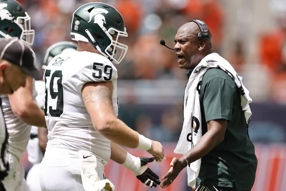 Michigan State head coach Mel Tucker celebrates with players after a field goal during the second quarter of an NCAA college football game against Miami, Saturday, Sept. 18, 2021, in Miami Gardens, Fla. (AP Photo/Michael Reaves)