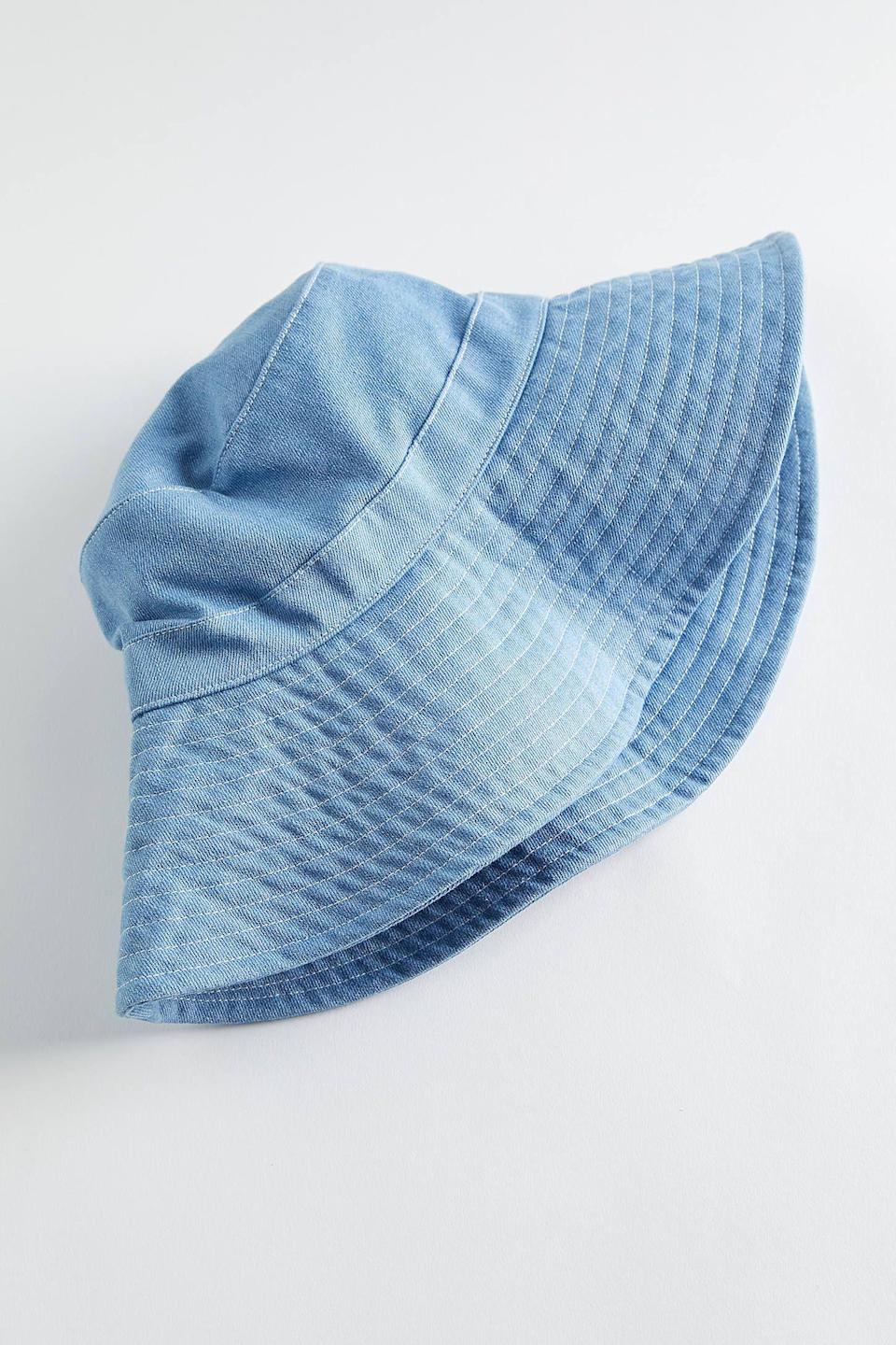 """<p><strong>Urban Outfitters</strong></p><p>urbanoutfitters.com</p><p><strong>$24.00</strong></p><p><a href=""""https://go.redirectingat.com?id=74968X1596630&url=https%3A%2F%2Fwww.urbanoutfitters.com%2Fshop%2Fwide-brim-denim-bucket-hat&sref=https%3A%2F%2Fwww.womenshealthmag.com%2Flife%2Fg33503014%2Fsecret-santa-gifts%2F"""" rel=""""nofollow noopener"""" target=""""_blank"""" data-ylk=""""slk:Shop Now"""" class=""""link rapid-noclick-resp"""">Shop Now</a></p><p>Say what you want about bucket hats, but they are very *in* right now. If you've got a fashion-forward friend, get them one of these denim-fabric toppers this year. </p>"""