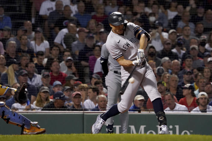 New York Yankees designated hitter Giancarlo Stanton (27) hits a three-run home run during the third inning of a baseball game against the Boston Red Sox at Fenway Park, Friday, Sept. 24, 2021, in Boston. (AP Photo/Mary Schwalm)