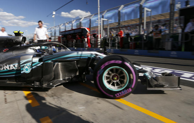 Mercedes driver Valtteri Bottas of Finland drives out of his garage during the second practice session at the Australian Formula One Grand Prix in Melbourne, Friday, March 23, 2018. The first race of the 2018 seasons is on Sunday. (AP Photo/Asanka Brendon Ratnayake)