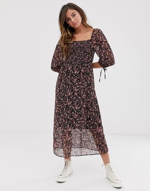 "<p>Our editors love this <a href=""https://www.popsugar.com/buy/New-Look-Shirred-Midi-Dress-485011?p_name=New%20Look%20Shirred%20Midi%20Dress&retailer=us.asos.com&pid=485011&price=45&evar1=fab%3Aus&evar9=45278025&evar98=https%3A%2F%2Fwww.popsugar.com%2Ffashion%2Fphoto-gallery%2F45278025%2Fimage%2F46553900%2FNew-Look-Shirred-Midi-Dress&list1=shopping%2Cfall%20fashion%2Cdresses%2Cfall%2Caffordable%20shopping&prop13=mobile&pdata=1"" rel=""nofollow"" data-shoppable-link=""1"" target=""_blank"" class=""ga-track"" data-ga-category=""Related"" data-ga-label=""https://us.asos.com/new-look/new-look-shirred-square-neck-midi-dress-in-ditsy-floral-print/prd/12418633?clr=multi&amp;colourWayId=16426724&amp;SearchQuery=&amp;cid=8799"" data-ga-action=""In-Line Links"">New Look Shirred Midi Dress </a> ($45).</p>"