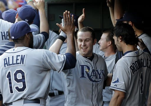 Tampa Bay Rays' Brandon Allen (19) and Sean Rodriguez (1) congratulate Evan Longoria, center, on his three-run home run off of Texas Rangers' Matt Harrison in the first inning of a baseball game, Friday, April 27, 2012, in Arlington, Texas. The shot scored Carlos Pena and Desmond Jennings. (AP Photo/Tony Gutierrez)