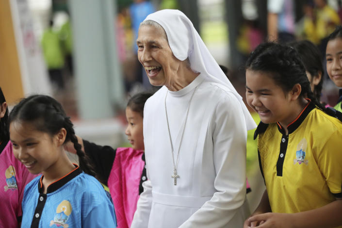 In this Aug. 27, 2019, photo, ST. Mary's School Vice Principal Sister Ana Rosa Sivori, center, talks to students during a lunch break at the girls' school in Udon Thani, about 570 kilometers (355 miles) northeast of Bangkok, Thailand. Sister Ana Rosa Sivori, originally from Buenos Aires in Argentina, shares a great-grandfather with Jorge Mario Bergoglio, who, six years ago, became Pope Francis. So, she and the pontiff are second cousins. (AP Photo/Sakchai Lalit)