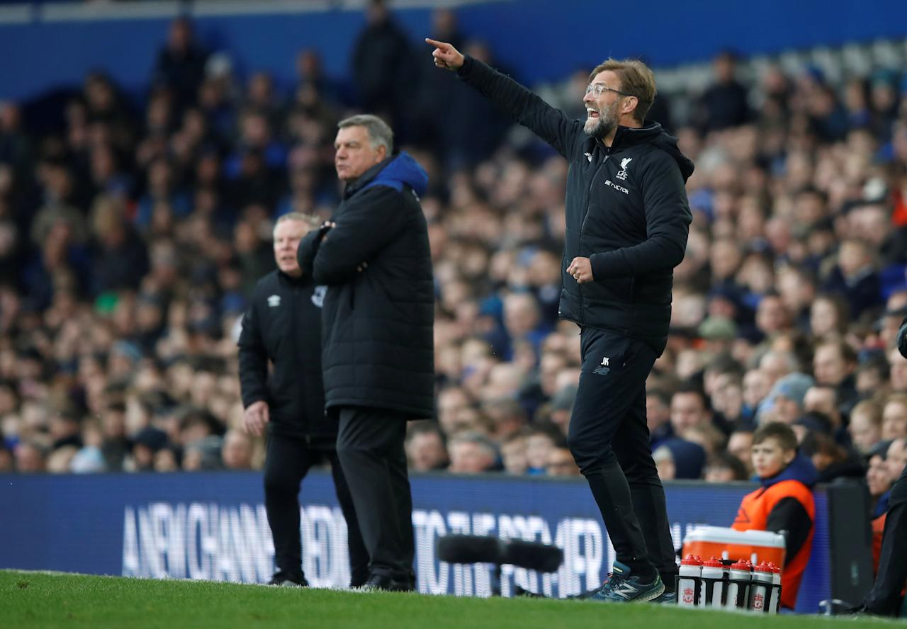 <p>Liverpool manager Juergen Klopp and Everton manager Sam Allardyce watch the action unfold </p>