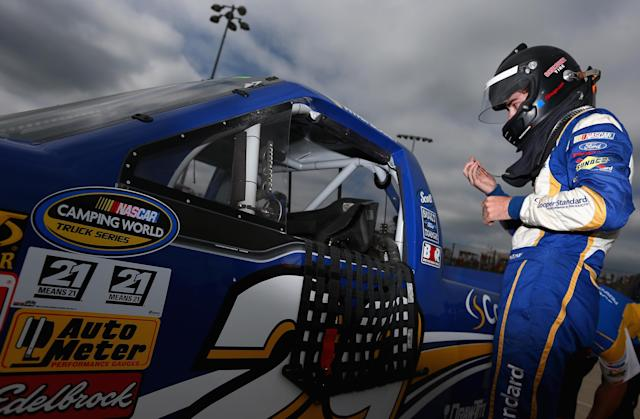 ROSSBURG, OH - JULY 24: Ryan Blaney, driver of the #29 Cooper Standard Ford, prepares for practice for the NASCAR Camping World Truck Series inaugural Mudsummer Classic at Eldora Speedway on July 24, 2013 in Rossburg, Ohio. (Photo by Tom Pennington/Getty Images)