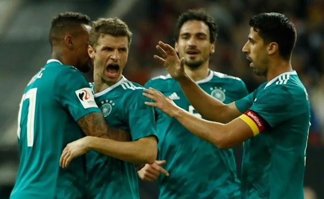 Great leveller: Thomas Mueller equalises for Germany in the 1-1 draw with Spain