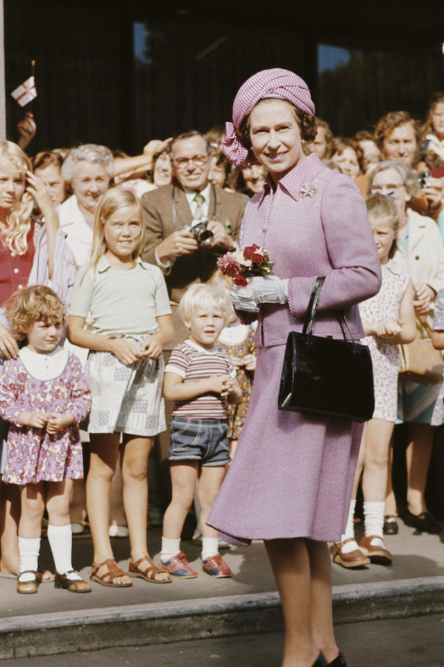 Queen Elizabeth II visited Christchurch during her visit to New Zealand in 1977 and greeted well-wishers in a powder pink skirt suit complete with a matching hat. <em>[Photo: Getty]</em>