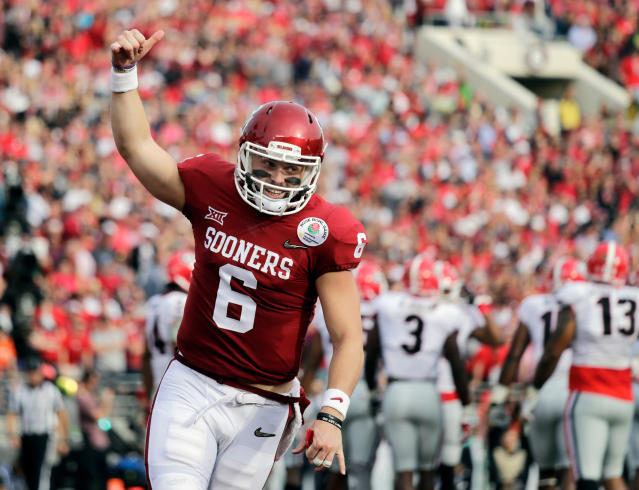 FILE - In this Jan. 1, 2018, file photo, Oklahoma quarterback Baker Mayfield celebrates after running back Rodney Anderson scored a touchdown against Georgia during the first half of the Rose Bowl NCAA college football game in Pasadena, Calif. Mayfield is expected to be a first round pick in the NFL Draft.(AP Photo/Jae C. Hong, File)