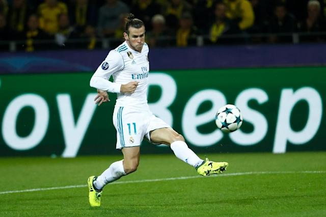 Real Madrid's Gareth Bale scores the opening goal during the Champions League match against Borussia Dortmund on September 26, 2017 (AFP Photo/Odd ANDERSEN)