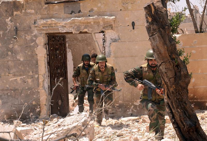 In this photo released on Sunday May 26, 2013, by the Syrian official news agency SANA, Syrian forces loyal to Syrian President Bashar Assad run to take their position during clashes against Syrian rebels, in Aleppo, Syria. Syria's Information Ministry says rebels have killed a TV correspondent who was covering clashes near the border with Lebanon. (AP Photo/SANA)