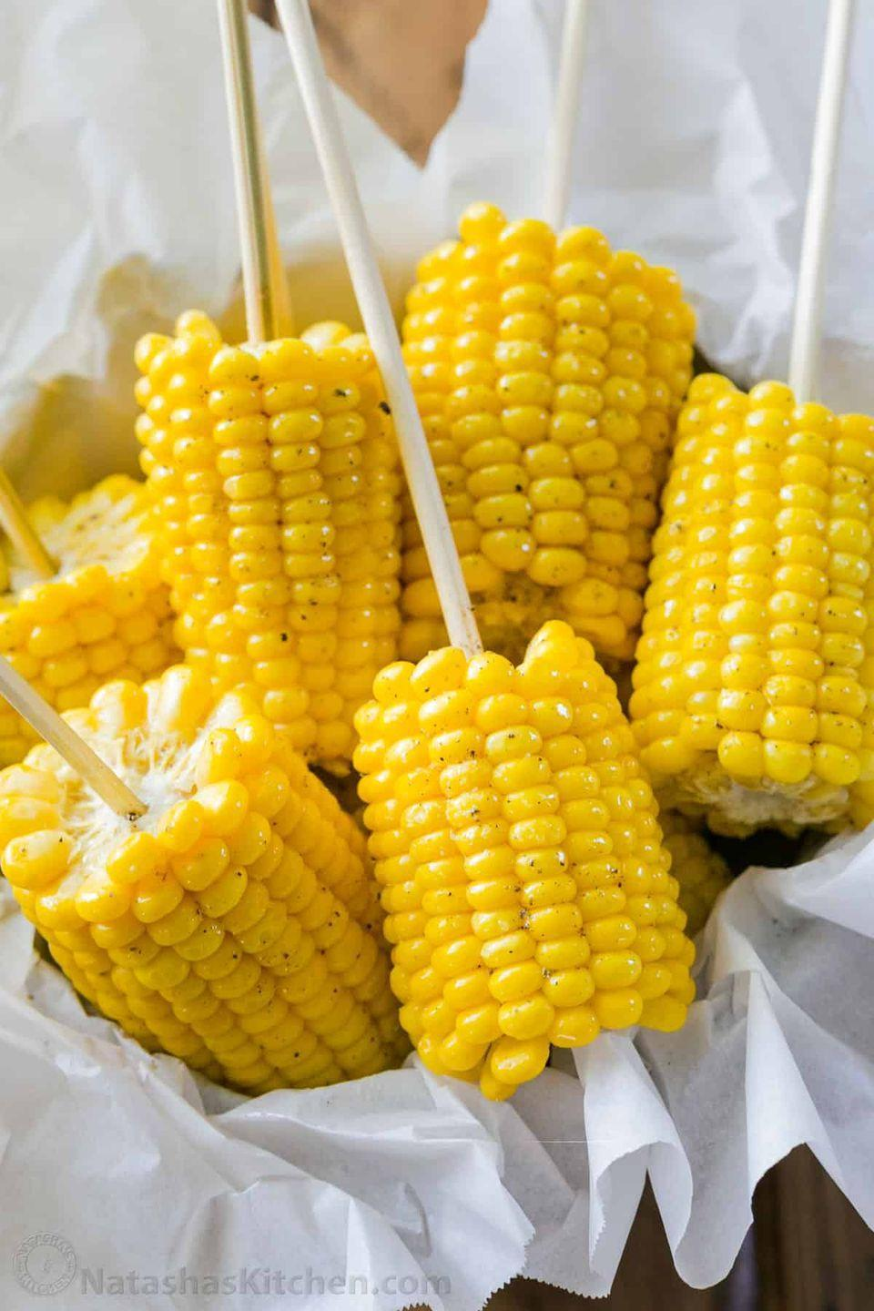 """<p>It doesn't get any easier than boiling corn. And here's a cool trick: Insert skewers into the cooked corn on the cob to make it easier to eat. </p><p><a href=""""https://natashaskitchen.com/15-minute-corn-on-the-cob/"""" rel=""""nofollow noopener"""" target=""""_blank"""" data-ylk=""""slk:Get the recipe."""" class=""""link rapid-noclick-resp"""">Get the recipe. </a></p>"""