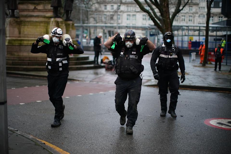 Enforcement officers remove items from an encampment in Euston Square Gardens in central London, where HS2 Rebellion protesters have built a 100ft tunnel network, which they are ready to occupy, after claiming the garden is at risk from the HS2 line development. Picture date: Wednesday January 27, 2021.