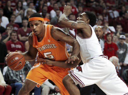 Tennessee's Jarnell Stokes (5) drives to the basket against Arkansas' Coty Carke (4) during the first half an NCAA college basketball game in Fayetteville, Ark., Saturday, Feb. 2, 2013. (AP Photo/Gareth Patterson)