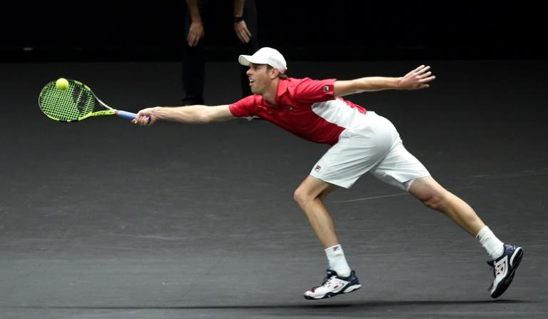 US Sam Querrey of Team World returns the ball to Swiss Roger Federer of Team Europe during second day of Laver Cup on September 23, 2017 in Prague