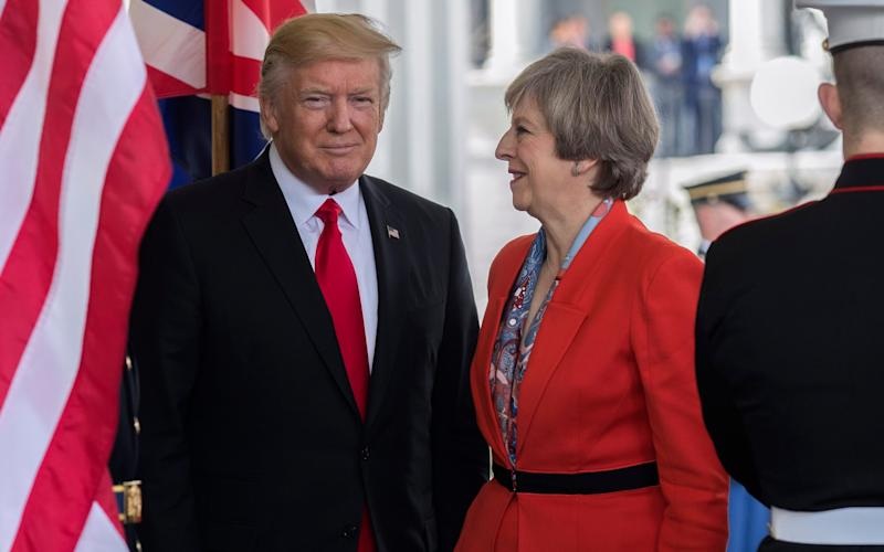 US President Donald Trump greets Theresa May at the White House in January - Credit: EPA