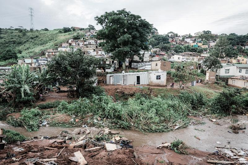 People abandon their homes at an informal settlement of BottleBrush, south of Durban, after torrential rains and flash floods destroyed their homes (AFP Photo/RAJESH JANTILAL)