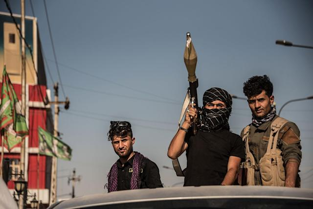 <p>Hashd al Shaabi troops in the turkman area of Kirkuk on Oct. 17, 2017, the day after they took the city from the Kurdish Peshmerga in fewer than 24 hours during an offensive instigated by the Iraqi Government in retaliation to the Kurdish Independence referendum held on the 25th September. (Photo : Elizabeth Fitt/SOPA Images/LightRocket via Getty Images) </p>