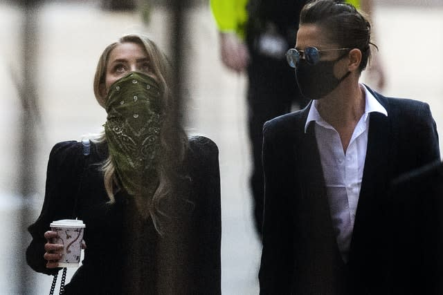 Amber Heard, left, arriving at the High Court