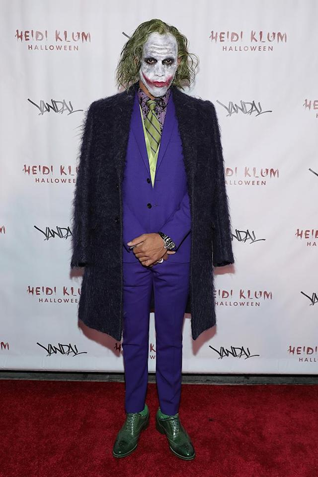 <p>The race car driver did his best impression of Heath Ledger's Joker at Heidi Klum's Halloween bash. (Photo: Neilson Barnard/Getty Images for Heidi Klum) </p>