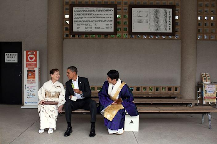 """""""Visiting the Great Buddha of Kamakura, in Japan, the President had a green tea ice cream bar with his hosts, Nov. 14, 2010. He had visited this Buddha as a young child and said he remembered sitting in the exact same place having an ice cream bar."""" (Pete Souza / The White House) <br> <br> <a href=""""http://lightbox.time.com/2012/10/08/pete-souza-portrait-of-a-presidency/#1"""" rel=""""nofollow noopener"""" target=""""_blank"""" data-ylk=""""slk:Click here to see the full collection at TIME.com"""" class=""""link rapid-noclick-resp"""">Click here to see the full collection at TIME.com</a>"""