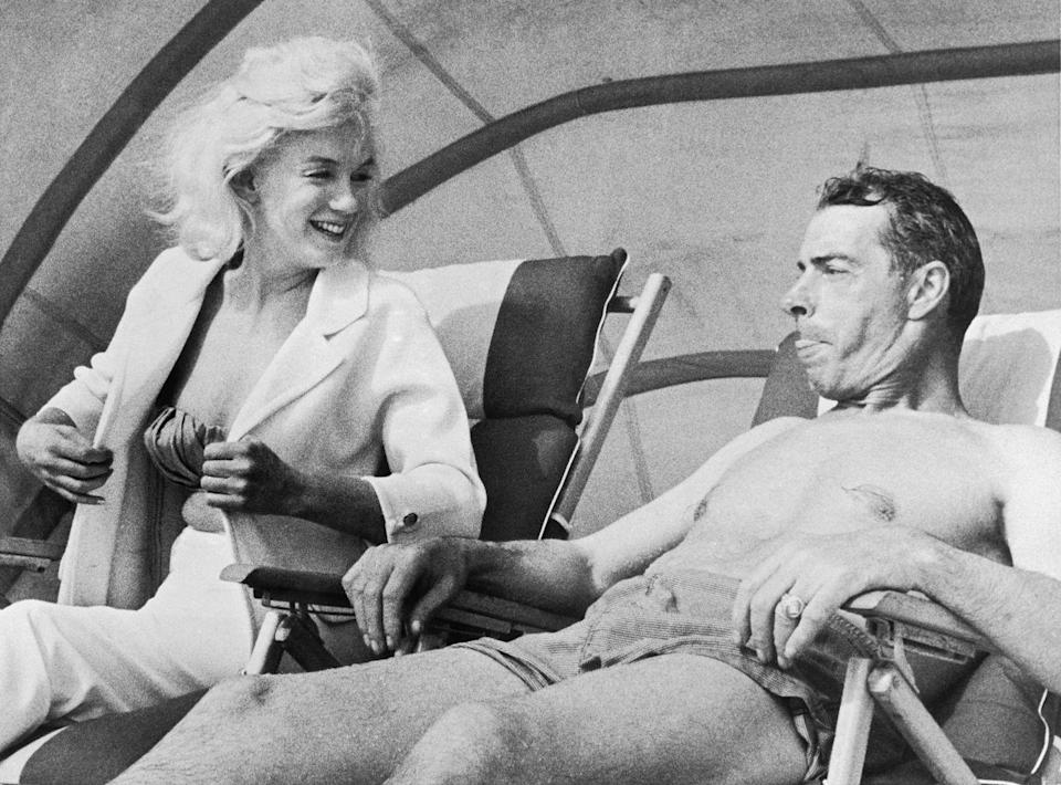 <p>Marilyn Monroe and Joe DiMaggio relax during New York Yankee spring training in 1961. </p>
