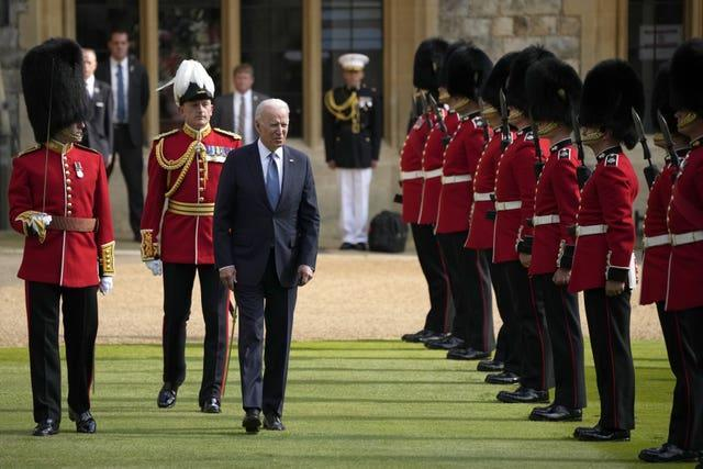US President Joe Biden inspects a Guard of Honour during a visit to Windsor Castle