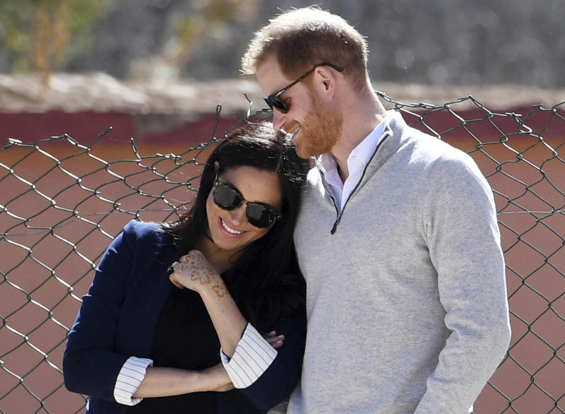 FILE - In this Sunday, Feb. 24, 2019 file photo, Britain's Prince Harry and Meghan, Duchess of Sussex, watch children playing football at a school in the town of Asni, in the Atlas mountains, Morocco. The time is drawing near for the impending royal birth of the first child for Prince Harry and his wife Meghan, the Duchess of Sussex. The couple is keeping many details about Meghan's pregnancy and birth plan private and say they don't know the baby's gender yet. (Facundo Arrizabalaga/Pool via AP, File)